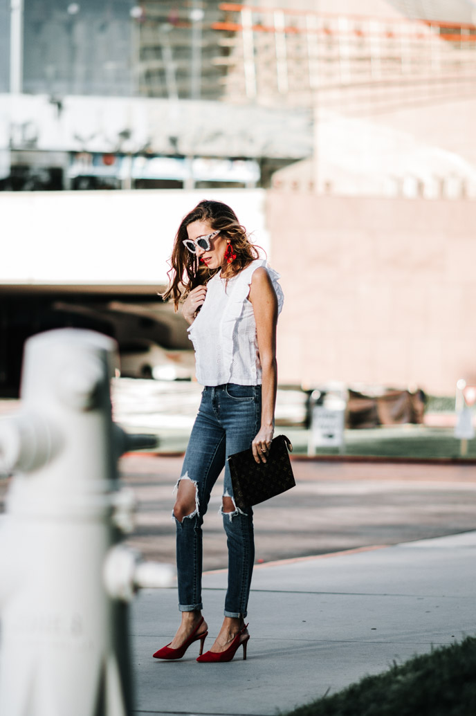 Eyelet top and ripped jeans