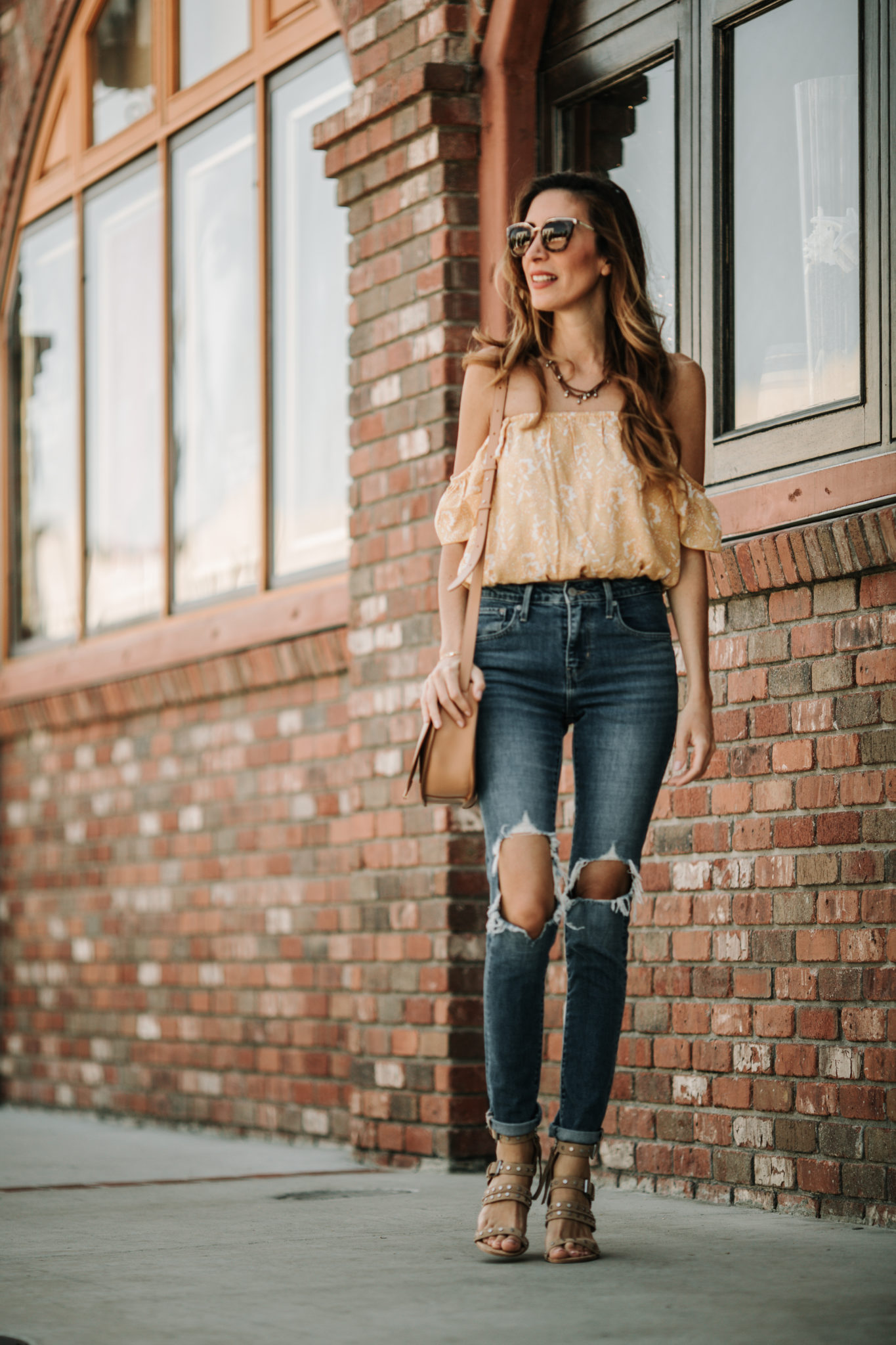 off the shoulder top and ripped jeans
