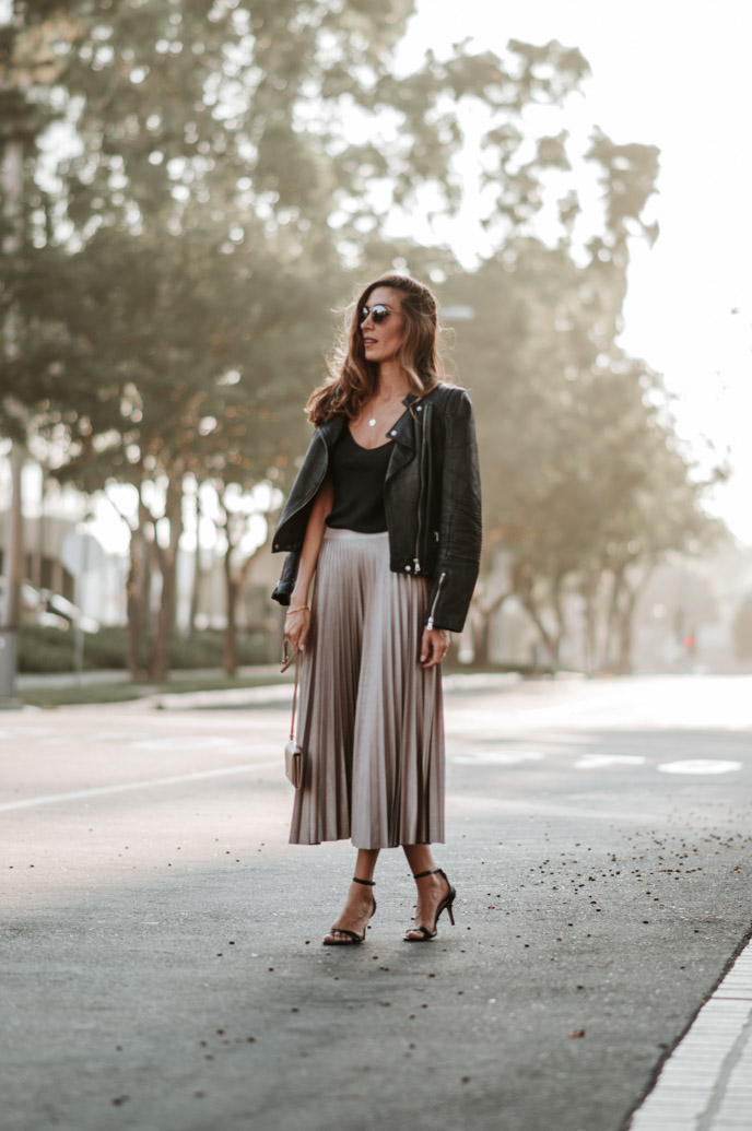 black camisole and pleated skirt